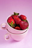 Strawberries in pink cups Royalty Free Stock Photo