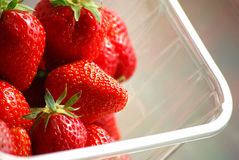 Strawberries in plastic box. Appetising red strawberries in a transparent plastic box Royalty Free Stock Photo