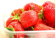 Strawberries in plastic box. Appetising red strawberries in a transparent plastic box royalty free stock photography