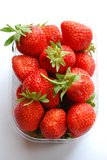 Strawberries in plastic box royalty free stock photos