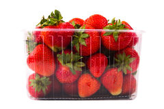 Strawberries in plastic box on white background Stock Photos