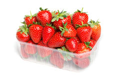 Strawberries in a plastic cup Stock Photos