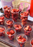 strawberries in plastic cup Royalty Free Stock Photos