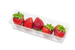 Strawberries in plastic tray Stock Photos
