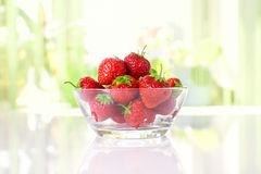 Strawberries in a plate. Fresh strawberries in a plate on the table Stock Image