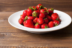 Strawberries on the plate Stock Photos