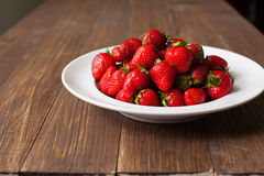 Strawberries on the plate Royalty Free Stock Images