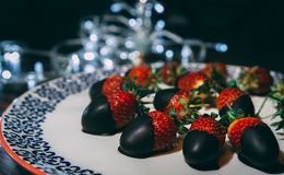 Close image of strawberries with chocolate. royalty free stock images