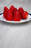 Strawberries on a plate Stock Photos