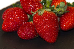 Strawberries on a plate Royalty Free Stock Images