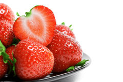 Strawberries on plate isolated on white background Stock Images