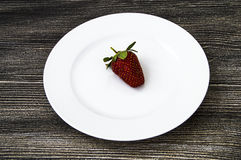 The strawberries on a plate,the most beautiful and appetizing strawberries pictures,strawberries on white background Stock Photography