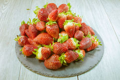 Strawberries. Plate with strawberries on a table Stock Photos