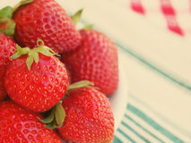 Strawberries on plate toned Stock Image