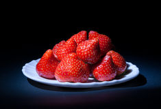 Strawberries on a plate. Strawberries on the white plate Stock Image