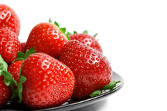 Strawberries on plate  on white background Stock Image