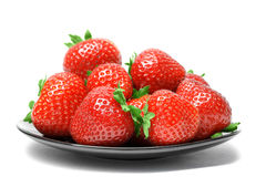 Strawberries on plate  on white background Stock Photos