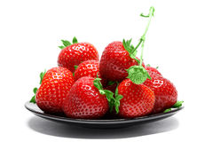 Strawberries on plate  on white background Royalty Free Stock Image