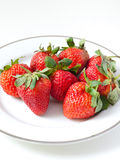 Strawberries in a plate on white Royalty Free Stock Photography