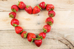 Strawberries positioned in a heart shape. Royalty Free Stock Image