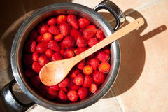 Strawberries in a pot for a jam Stock Photos