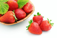 Strawberries. In a pot  on the white background Stock Photos