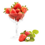 Strawberries in a pot. On the white background Stock Photography