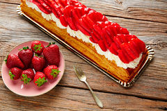 Strawberries puff pastry pie on wood Stock Image