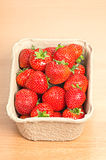 Strawberries in a punnet. Fresh ripe strawberries in a punnet royalty free stock photos