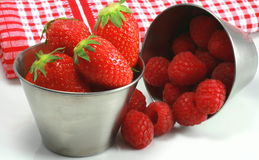 Strawberries and raspberries Stock Images