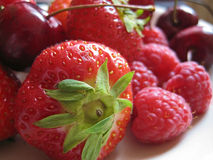 Strawberries and raspberries. Strawberries, red raspberries and cherries Royalty Free Stock Photography