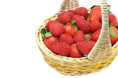 Strawberries and raspberries in the basket. Strawberries and raspberries are in a wicker basket for fruit Stock Image