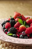 Strawberries, raspberries and blackberries. On plate Royalty Free Stock Images
