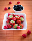 Strawberries, raspberries, blackberries. Composition on table Royalty Free Stock Photo