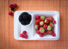 Strawberries, raspberries, blackberries. Composition on table Stock Image