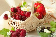 Strawberries, raspberries, currants and cherries. Decorated table with spring fruits and berries Stock Photos