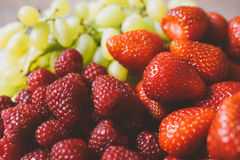 Strawberries, raspberries and grapes closeup Royalty Free Stock Photo