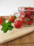 Strawberries with raw cane sugar and mint Royalty Free Stock Photo