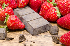 Strawberries raw chocolate on whooden table Royalty Free Stock Photography