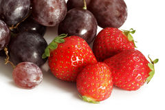 Strawberries with red grapes Royalty Free Stock Photography