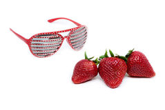Strawberries and red modern eyeglasses Stock Photography