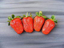 Strawberries on the rustic floor, strawberries in the plate, lovely beautiful strawberry pictures, Stock Photography
