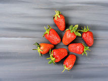 Strawberries on the rustic floor, strawberries in the plate, lovely beautiful strawberry pictures, Royalty Free Stock Images