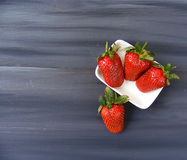 Strawberries on the rustic floor, strawberries in the plate, lovely beautiful strawberry pictures, Royalty Free Stock Photography