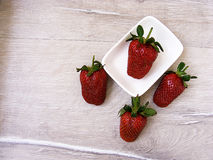 Strawberries on the rustic floor, strawberries in the plate, lovely beautiful strawberry pictures, Royalty Free Stock Photos