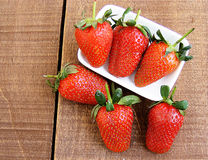 Strawberries on the rustic floor, strawberries in the plate, lovely beautiful strawberry pictures, Stock Photo