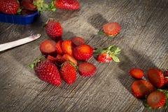 Strawberries, rustic wood Stock Images