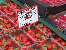 Strawberries at a British Farmer`s Market. Strawberries for sale at a farmer`s market in Chichester, West Sussex, England. Sign reads `English Strawbs; Lovely stock photography