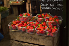 Strawberries on sale at fruit stand Stock Image