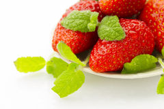Strawberries on saucer Stock Images